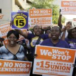 "Miami protestors support the ""Fight for 15,"" a campaign for a higher minimum wage. (AP Photo/Lynne Sladky)"
